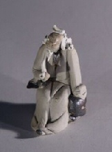 "Ceramic Figurine  - Man With Pipe 1.5""x1.5""x2.5"""