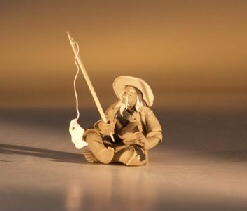 "Ceramic  Figurine - Mudman Fisherman 1.25""x1.25""x1.75"