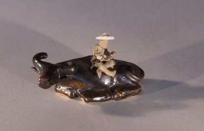 Ceramic Figurine  - Man Sitting on Water Buffalo